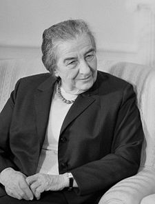 Golda Meir, the first member of Warhol's minyan, takes a seat and waits for the others.